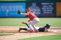 Philadelphia Phillies Madison Stokes (15) waits to receive a pick off throw as Kyle Gray (2) dives back to the base during a Florida Instructional League game against the New York Yankees on October 12, 2018 at Spectrum Field in Clearwater, Florida.  (Mike Janes/Four Seam Images)