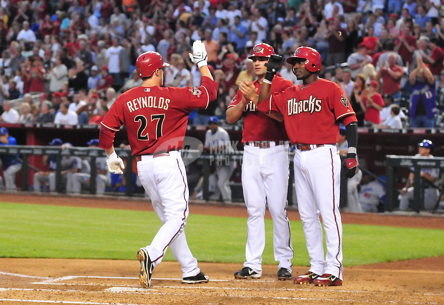 Apr. 8, 2008; Phoenix, AZ, USA; Arizona Diamondbacks first baseman (34) Conor Jackson and Orlando Hudson congratulate third baseman Mark Reynolds after he hit a three run home run in the first inning against the Los Angeles Dodgers at Chase Field. Mandatory Credit: Mark J. Rebilas-US PRESSWIRE