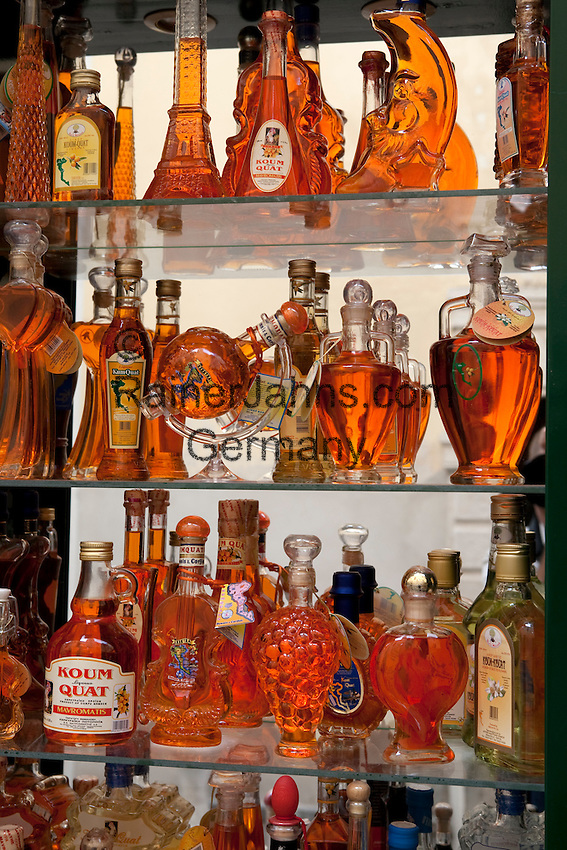 Greece, Corfu, Corfu-Town (Kerkyra): Kumquat Liqueur on display in tourist shop