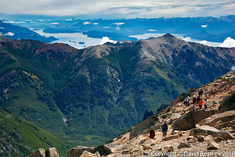 The view behind a group of trekkers on the Refugio Frey Trail is stunning and what makes this difficult trail such a winner.  Located in Parque Nacional Nahuel Huapi near Bariloche, Argentina.