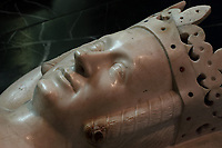 Effigy of Jeanne de Bourbon, 1338-77, wife of Charles V, holding a bag indicating that only the entrails of the deceased are buried here, originally from the Eglise des Celestins in Paris and moved to Saint-Denis in 1816, in the Basilique Saint-Denis, Paris, France. The basilica is a large medieval 12th century Gothic abbey church and burial site of French kings from 10th - 18th centuries. Picture by Manuel Cohen