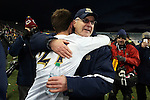 15 December 2013: Notre Dame head coach Bobby Clark (SCO) (right) embraces Patrick Hodan (27) after the game. The University of Maryland Terripans played the University of Notre Dame Fighting Irish at PPL Park in Chester, Pennsylvania in a 2013 NCAA Division I Men's College Cup championship match. Notre Dame won the game 2-1.