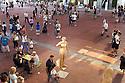 Even the wood sculpture of Val Gardena, at the stand of Trentino Alto Adige in Expo 2015, holds a digital camera, Rho-Pero, Milan, in June 2015. &copy; Carlo Cerchioli <br /> <br /> Anche la scultura in legno della val Gardena, allo stand del Trentino Alto Adige a Expo 2015, impugna una macchina fotografica digitale, Rho-Pero, Milano, giugno 2015.