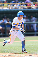 Brett Stephens #23 of the UCLA Bruins runs to first base during a game against the Oregon Ducks at Jackie Robinson Stadium on May 18, 2014 in Los Angeles, California. Oregon defeated UCLA, 5-4. (Larry Goren/Four Seam Images)