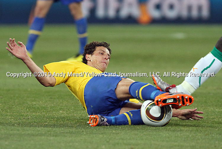 20 JUN 2010:  Elano (BRA)(ground) is seriously injured on this play.  The Brazil National Team defeated the C'ote d'Ivoire National Team 3-1 at the end of the first half at Soccer City Stadium in Johannesburg, South Africa in a 2010 FIFA World Cup Group G match.