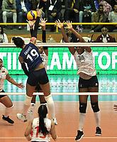 BOGOTÁ-COLOMBIA, 07-01-2020: Amanda Coneo de Colombia, clava el balón a Alejandra Arguello y Aleoscar Blanco de Venezuela, durante partido entre Venezuela y Colombia en el Preolímpico Suramericano de Voleibol, clasificatorio a los Juegos Olímpicos Tokio 2020, jugado en el Coliseo del Salitre en la ciudad de Bogotá del 7 al 9 de enero de 2020. / Amanda Coneo from Colombia, spikes the ball to Aleoscar Blanco and Ahizar Zuñiga Alejandra Argello and Aleoscar Blanco between Venezuela and Colombia, in the South American Volleyball Pre-Olympic Championship, qualifier for the Tokyo 2020 Olympic Games, played in the Colosseum El Salitre in Bogota city, from January 7 to 9, 2020. Photo: VizzorImage / Luis Ramírez / Staff.
