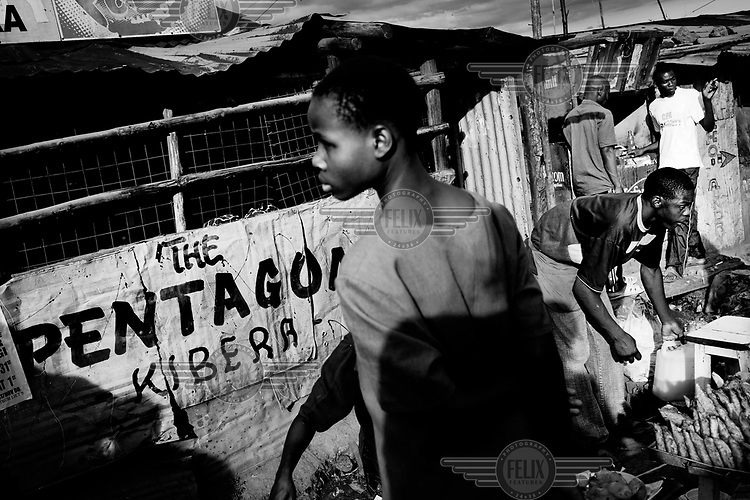 People go about their business in Kibera. Over 25 percent of Nairobi's population live in Kibera, an area that covers less than one percent of the city. Although the population of the slum is over one million, it is recognised officially as a 'squat', or illegally occupied land, which allows the government to ignore the basic needs of the inhabitants.