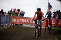 Lars Van der Haar (NLD) holds off Kevin Pauwels (BEL) for 2nd place in the race while kicking up some mud<br /> <br /> Elite Men's race<br /> <br /> 2015 UCI World Championships Cyclocross <br /> Tabor, Czech Republic