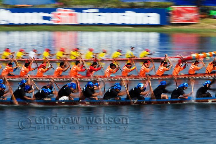 Longboat teams race during the Wax Castle festival.  The festival marks the end of Buddhist lent or 'Ok Phansa'.  Sakhon Nakhon, Sakhon Nakhon, THAILAND
