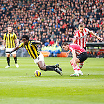 Nederland, Eindhoven, 25 november  2012.Eredivisie.Seizoen 2012-2013.PSV-Vitesse.Kevin Strootman (2e van rechts) van PSV brengt Wilfried Bony (l.) van Vitesse ten val. Rechts Timothy Derijck van PSV..