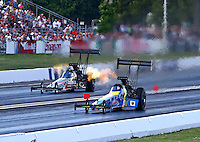 Jun. 1, 2013; Englishtown, NJ, USA: NHRA top fuel dragster driver Sidnei Frigo (near lane) races alongside Larry Dixon during qualifying for the Summer Nationals at Raceway Park. Mandatory Credit: Mark J. Rebilas-
