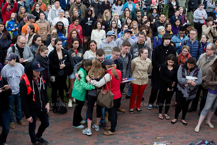 People gather near the Parkman Bandstand in Boston Common in Boston, Mass., for a vigil on April 16, 2013, the day after bombings at the Boston Marathon.