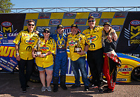Apr 23, 2017; Baytown, TX, USA; NHRA top fuel driver Leah Pritchett (right) celebrates with funny car driver Ron Capps and Pennzoil guests after winning the Springnationals at Royal Purple Raceway. Mandatory Credit: Mark J. Rebilas-USA TODAY Sports