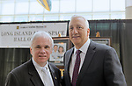 Garden City, NY, USA. June 21, 2018. R-L, former NASA astronaut MICHAEL MASSIMINO poses with ANDREW PARTON the Executive Director of the Cradle of Aviation Museum, at Long Island Air & Space Hall of Fame Class of 2018 Induction at Cradle of Aviation.