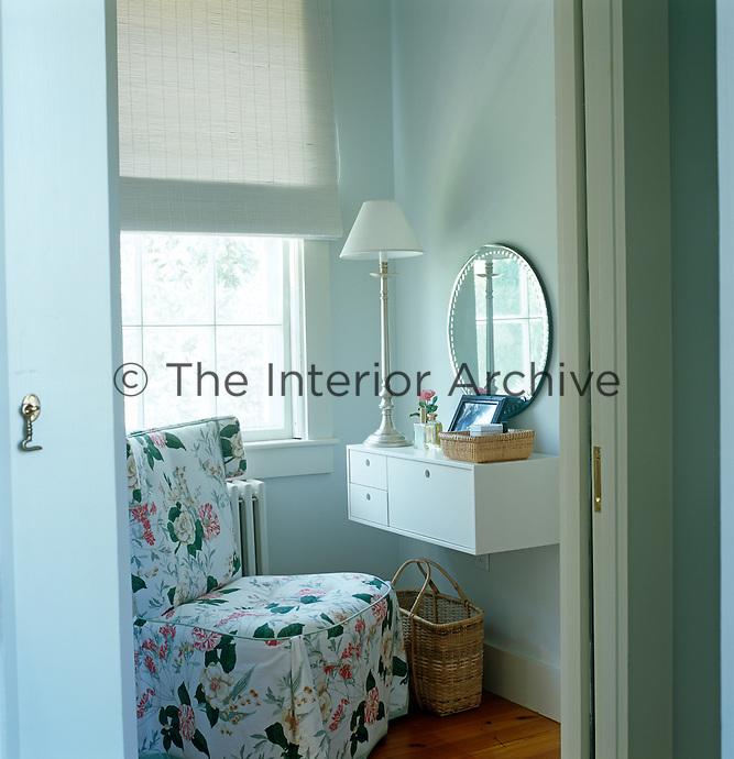 Glimpse through an open door into the corner of a bathroom