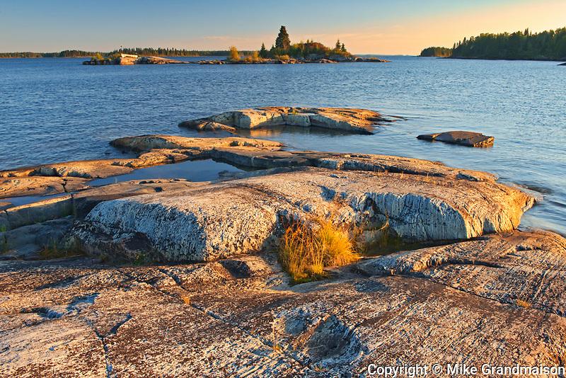 Rocky shoreline of Setting Lake at sunrise<br />Setting Lake Wayside Park near Wabowden<br />Manitoba<br />Canada