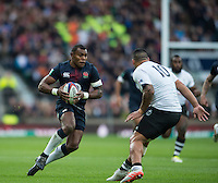 Twickenham, United Kingdom. Engalnd&rsquo;s, Semesa ROKOODUGUNI, faces, Fijian, Josh MATAVESI, during the Old Mutual Wealth Series Rest Match: England vs Fiji, at the RFU Stadium, Twickenham, England, Saturday  19/11/2016<br />
