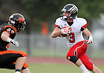 SIOUX FALLS, SD - SEPTEMBER 27:  AJ Garrow #3 from Brandon Valley looks to cut back against Rodney Mullen #42 from Washington in the first quarter of their game Friday night at Howard Wood Field. (Photo by Dave Eggen/Inertia)