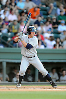First baseman Chris Breen (8) of the Charleston RiverDogs bats in a game against the Greenville Drive on Sunday, May 24, 2015, at Fluor Field at the West End in Greenville, South Carolina. Charleston won 3-2. (Tom Priddy/Four Seam Images)