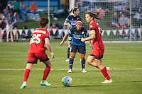 Kansas City, Mo. - Saturday April 23, 2016: FC Kansas City defender Desiree Scott (3) waits in defense during a match against Portland Thorns FC at Swope Soccer Village. The match ended in a 1-1 draw.