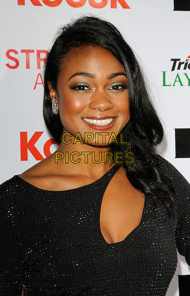 TATYANA ALI.The International Academy of Web Television's 2nd Annual Streamy Awards at the Orpheum Theatre in Los Angeles, California, USA..April 11th, 2010.headshot portrait smiling black cut out cleavage sparkly green eyeshadow make-up.CAP/ROT.©Lee Roth/Capital Pictures