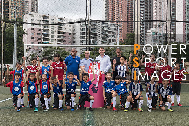 From left to right: Mark Bright,  Mark Sutcliffe, Richard Masters, Phil Babb, and Hong Kong children pose for a group photo with the Premier League Asia Trophy in front of the Hong Kong skyline for the launch of the Premier League Asia Trophy 2017 at the Hong Kong Football Club on 01 June 2017 in Hong Kong, China.