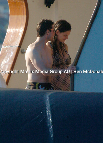 17 FEBRUARY 2006 SYDNEY AUSTRALIA<br /> <br /> Tom Cruise and Katie Holmes on the Artic P after swimming in Sydney Harbour following the memorial service of the Late Kerry Packer. James Packer is pictured with his wife Erica and close friends Lachlan &amp; Sarah Murdoch