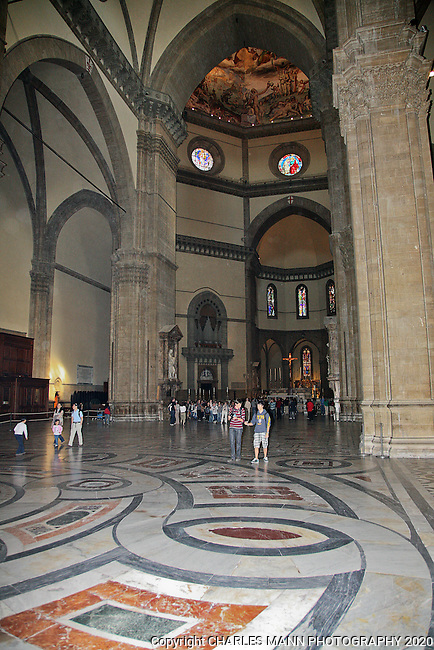 The colorful Duomo cathedral dominates the central plaza or piazza of Florence. The interior reveals the Romanesque style.
