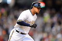 Milwaukee Brewers outfielder Carlos Gomez #27 runs to first after hitting a home run during a game against the Minnesota Twins at Miller Park on May 27, 2013 in Milwaukee, Wisconsin.  Minnesota defeated Milwaukee 6-3.  (Mike Janes/Four Seam Images)