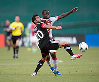 Carlos Ruiz (20) of D.C. United fights for the ball with Andrew Jean-Baptiste (35) of the Portland Timbers during a Major League Soccer match at RFK Stadium in Washington, DC.  The Portland Timbers defeated D.C. United, 2-0.