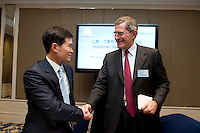 Shanghai Office of Financial Services Director-General Fang Xinghai (left) shakes hands with GDF Suez CEO and Paris Europlace Chairman Gerard Mestrallet (right), at the signature ceremony of a Memorandum of Understanding between Paris Europlace and Shanghai Financial Services, at Shanghai / Paris Europlace Financial Forum, in Shanghai, China, on December 1, 2010. Photo by Lucas Schifres/Pictobank