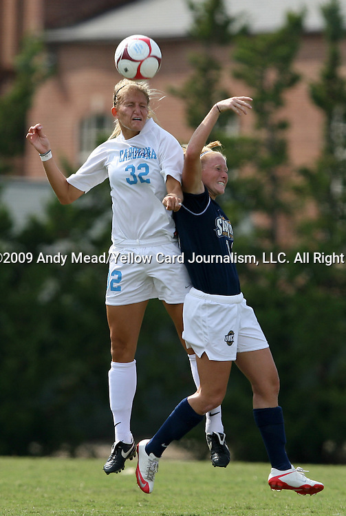 30 August 2009: North Carolina's Kristi Eveland (32) and Greensboro's Tabitha Padgett (right). The University of North Carolina Tar Heels defeated the University of North Carolina Greensboro Spartans 1-0 at Fetzer Field in Chapel Hill, North Carolina in an NCAA Division I Women's college soccer game.