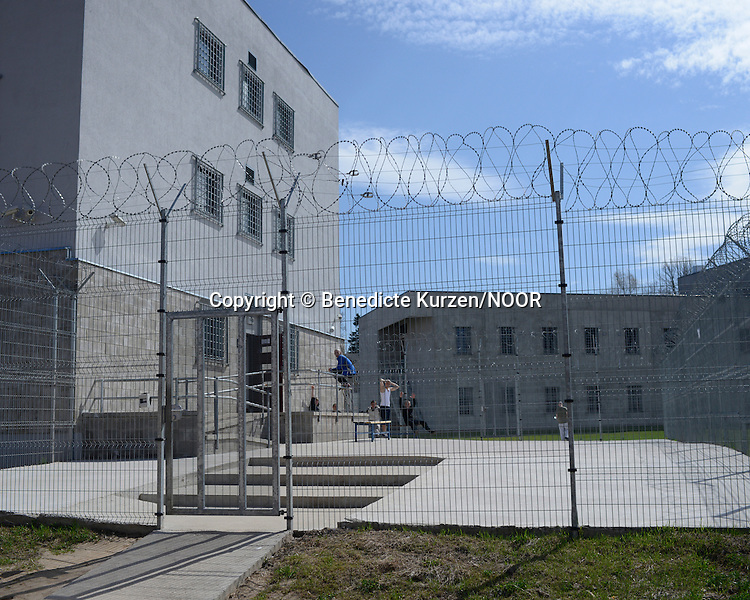 Inmates enjoy the sun in the courtyard of the newly built prison premises and building at the Cesu correctional institution of juveniles which has been renovated in one part and newly built in other part, Cesu, May 2013. <br /> <br /> There are 50 inmates at the moment at the correctional institution. During the day inmates are allowed to go in and out of their cells.