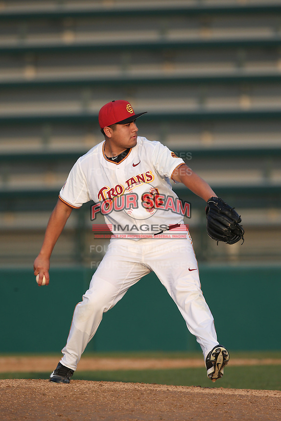 Alex Chavez (32) of the Southern California Trojans pitches during a game against the Oakland Grizzlies at Dedeaux Field on February 21, 2015 in Los Angeles, California. Southern California defeated Oakland, 11-1. (Larry Goren/Four Seam Images)