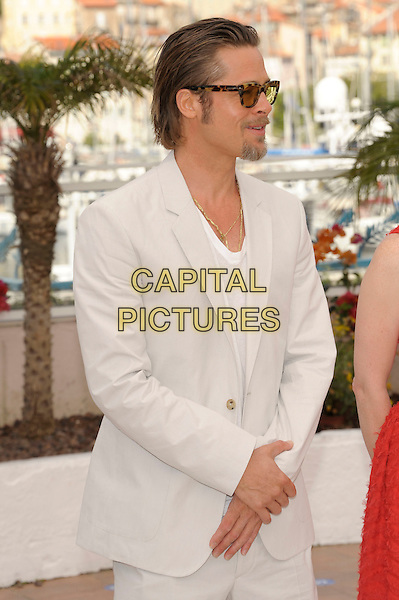 BRAD PITT.'The Tree of Life' photocall at the Palais des Festival, 64th International Cannes Film Festival, France.16th May 2011.half length white top grey gray beige suit sunglasses shades tinted goatee facial hair profile.CAP/PL.©Phil Loftus/Capital Pictures.