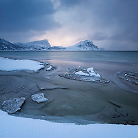 Snow covered Haukland beach in winter, Vestvågøy, Lofoten Islands, Norway