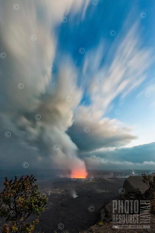 A long exposure view of Halema'uma'u Crater at sunset with dramatic clouds, Hawai'i Volcanoes National Park, Big Island.