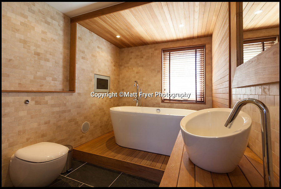BNPS.co.uk (01202 558833)<br /> Pic: Jackson-Stops/BNPS<br /> <br /> ****Please use full byline****<br /> <br /> One of the three plush bathrooms.<br /> <br /> A stunning cliff-top house has grown into a 1.25 million pounds property after it was built on a disused allotment.<br /> <br /> Jamie and Zoe McLintock forked out £80,000 for the overgrown plot of land eleven years ago because it was atop a cliff along Devon's craggy coastline.<br /> <br /> The enterprising couple spent a further £600,000 and three years of their time building the beautiful five-bedroom pad.<br /> <br /> But they are now set to double their money after the incredible property went on the market for a whopping £1.25 million with estate agents Jackson-Stops.<br /> <br /> The white-washed three-storey house is perched on top of 100ft cliffs overlooking Tunnels Beaches in Ilfracombe, a stretch of private Victorian beach owned by the couple since 2001.