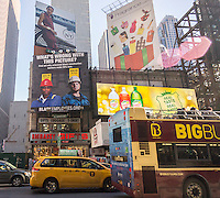 A billboard in Times Square in New York on Sunday, November 29, 2015 questions the commitment of construction unions to diversity by implying that black workers are paid less than white. The billboard is the work of the Center for Union Facts via lobbyist Richard Berman who has also created billboards fighting the raise in minimum wages and paid sick leave.   (© Richard B. Levine)