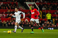 Saturday 11 January 2014 Pictured: Leon Britton gets ahead of Danny Welbeck  of Manchester United<br /> Re: Barclays Premier League Manchester Utd v Swansea City FC  at Old Trafford, Manchester