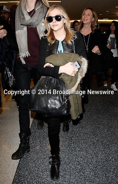 Pictured: Chloe Moretz<br /> Mandatory Credit &copy; CALA/Broadimage<br /> Chloe Moretz arrives at the Los Angeles International Airport<br /> <br /> 1/19/14, Los Angeles, California, United States of America<br /> <br /> Broadimage Newswire<br /> Los Angeles 1+  (310) 301-1027<br /> New York      1+  (646) 827-9134<br /> sales@broadimage.com<br /> http://www.broadimage.com
