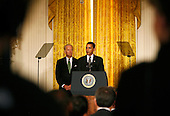Washington, DC - February 20, 2009 -- United States President Barack Obama, right, and Vice President Joe Biden, left, address mayors from across the United States,  in the East Room of the White House, Washington, DC, Friday February 20, 2009..Credit: Aude Guerrucci - Pool via CNP