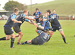 No Way Through .Westport Liam Scahill gets tackled by Brian Flannery and Daire Mulgrew.during the Junior Cup game in Carrowholly.. .Pic Conor McKeown