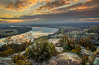 Sunrise over the Arkansas River as seen from the Petit Jean Gravesite Overlook at Petit Jean State Park near Morrilton Arkansas.