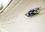 """5 December 2015: Sandra Robatscher, competing for Italy, slides through Curve 10 """"Shady"""" on her first run of the Viessmann World Cup Women's Luge at the Olympic Sports Track in Lake Placid, New York, USA. Mandatory Credit: Ed Wolfstein Photo *** RAW (NEF) Image File Available ***"""