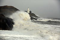 WEATHER PICTURE WALES<br /> Pictured: Waves crashing against rocks in Bracelet Bay by Mumbles Lighthouse, south Wales. Wednesday 12 February 2014<br /> Re: 100mph winds have been forecast with severe flood warnings issued for many parts of the UK.