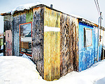 Multi coloured plywood shack in the Woodyard.