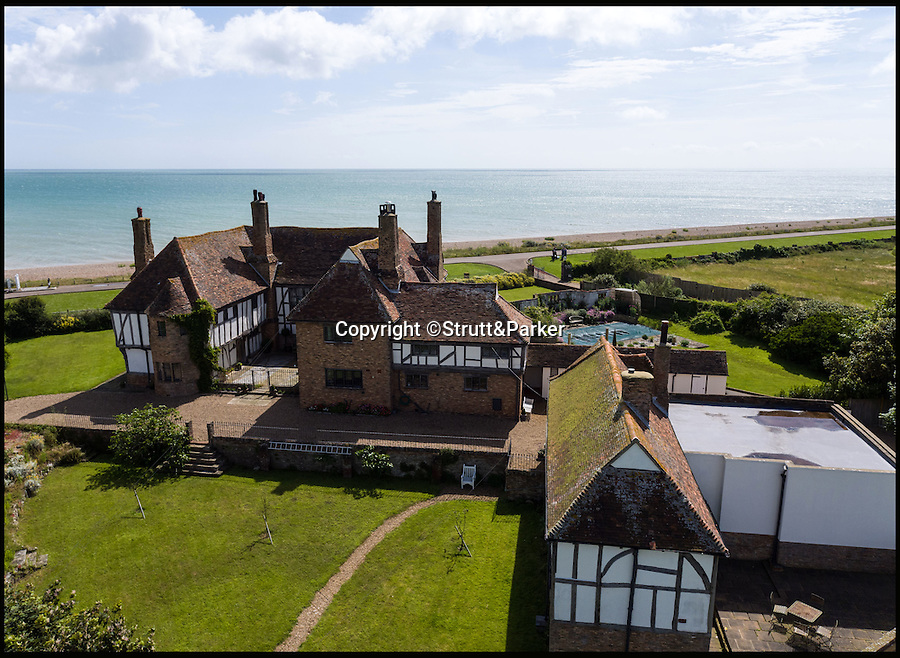 BNPS.co.uk (01202 558833)<br /> Pic: Strutt&Parker/BNPS<br /> <br /> Clear views east to France.<br /> <br /> Tudor flat packed home just a short sand wedge from the beach AND the golf course.<br /> <br /> This stunning beachside property comes with sea views as far as Europe and a top golf course on the doorstep.<br /> <br /> Kentlands is a Grade II listed Arts & Crafts home on the private Sandwich Bay estate in Kent with direct access to a beautiful, quiet beach.<br /> <br /> The house is also right next door to the world famous Royal St George's Golf Club, one of the few courses where the British Open is held, and is expected to appeal to professional players.<br /> <br /> But you'll need a decent wedge to buy it - the property is on the market with Strutt & Parker for £3.3million.