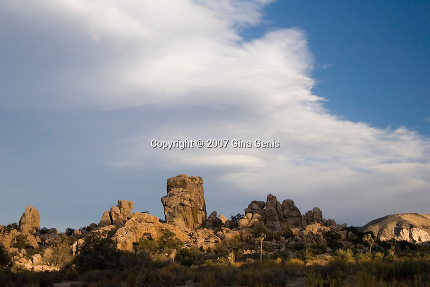 Boulders of Joshua Tree under a cloudy sky