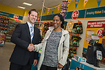 Dealz Fonthill Road . Staff Members .  Store Manager Ian Kendellen  with First Customer Joyce Henaku from Lucan.